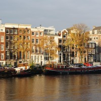 Early morning fall sun on the Amstel Canal houses