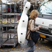 Common site in Amsterdam, someone walking or biking with a cello on their back.