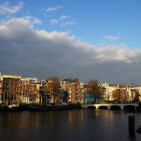 Fall light on houses and Skinny Bridge on the Amstel