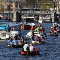 Floating Dutchman Bus surrounded by canal traffic