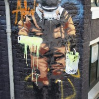Bustart random street art deep sea diver/painter