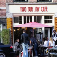 Two for Joy Cafe, people taking off work to enjoy the sun.