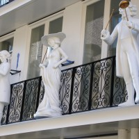 Bell statues on a balcony