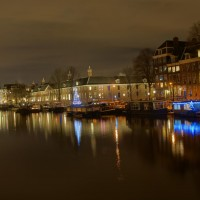 Houseboats on the Amstel River along the Hermitage museum, decorated for Christmas
