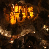 Tiny Christmas village in someone's living room window.