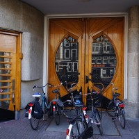 Beautiful door to 'the Ladies Gym' blocked by bikes.