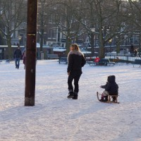 More wintersports. Mom taking kids on a sled ride across the Amstelveld park.