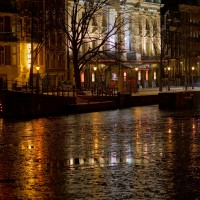 Frozen Amstel in front of the Carré Theatre seen from the Magerebrug