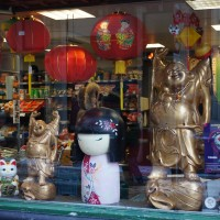 Giant Kimi doll in the window of the Dun Yong Chinese shop