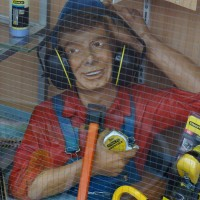 Disturbing display in a hardware store window. This is NOT how you wear hearing protection.