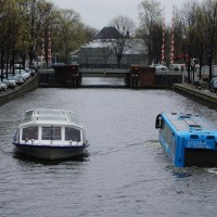 The Floating Dutchman bus passing Hortus Botanical gardens on the Herengracht.