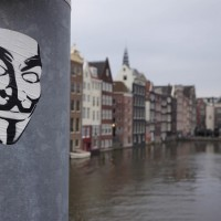 "Guy Fawkes mask, sign of the ""Anonymous"" and ""Occupy"" groups."