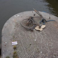 Dead bike on a bridge pylon. Maybe it jumped.