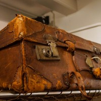 Ancient leather suitcase, now decoration in a restaurant.