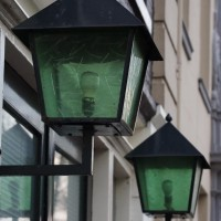 Green lamps on a house near Entrepotdok