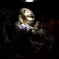 Many religions are represented in Cafe Kadijk. Buddah under a spotlamp.