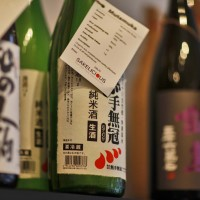 Some huge bottles of Sake on the top shelf