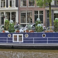 Brouwersgracht houseboat with bottle trees on deck