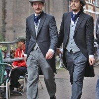 Two well-dressed gentlemen on the Oudezijds Kolk
