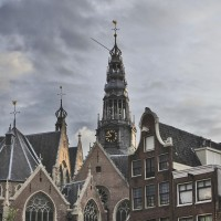 The spire of the Old Church above the gables (Oudekerk)