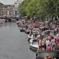 Crowds along the Prinsengracht Canal Parade route.