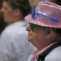 2 sets of blinking LED glasses and a pink sequened hat