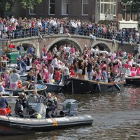Boats and people on the Amstel part of the Canal Parade
