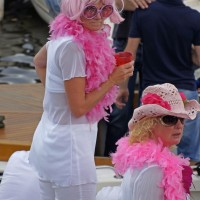 Fabulous ladies watching the parade from their boat