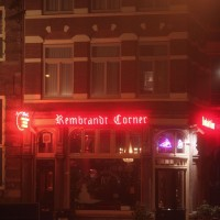 Rembrandt Corner Café (next to Rembrandt House) glowing red in the fog