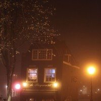 The Sluyswacht Café looking very gezellig, romantic and cozy in the foggy evening
