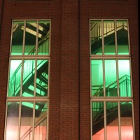 Colorfully lit stairwell of a building on the Reguliersdwarsstraat near the pink light district